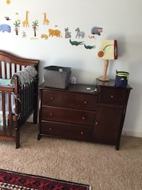 Brown wooden dresser and a bed Calgary, T3M