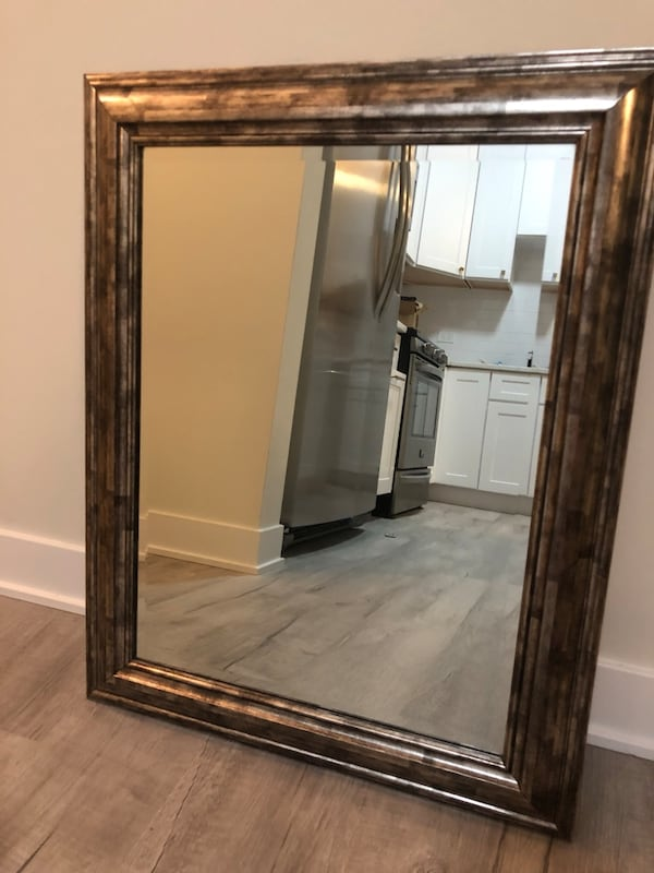 Like new metallic yet silver trimmed mirror 4a85af18-d001-4804-a291-29e6f35f26cc
