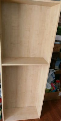 Tall light colored bookcase