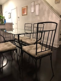 Black metal framed glass top table with chairs