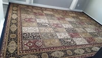 brown, red, and beige floral area rug