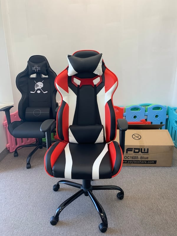 Black white red gaming chair with recliner e3d931ae-f7d0-4bb7-ada5-6011f6bd2340