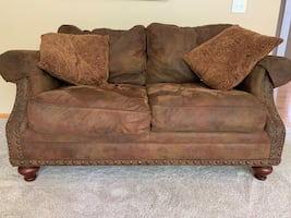 Brown loveseat from Home Furniture