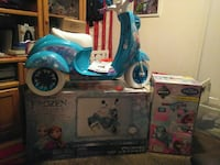 blue and white Disney Frozen themed ride-on motorcycle toy with box