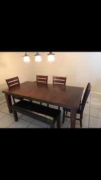 rectangular brown wooden table with four chairs dining set Lakeland, 33810