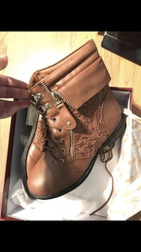pair of brown leather work boots East Lake, 33610
