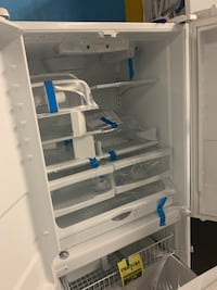 New scratch and dent whirlpool French door fridge working perfectly  Baltimore, 21223
