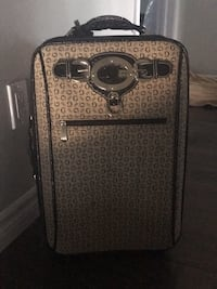 Guess luggage. Size Medium.  Cambridge, N3C 3C3