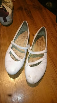 pair of white leather slip on shoes
