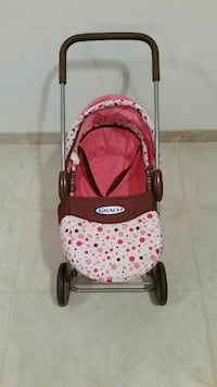 red and pink Graco stroller