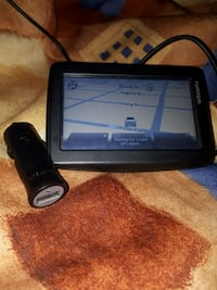 TomTom GPS with mount and car charger Welland, L3B 3N7