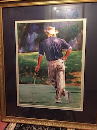 Man holding golf wedge painting with brass-frame Fort Wayne, 46803