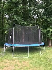 Black and blue trampoline with enclosure, ladder included Burke, 22015