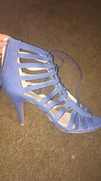 pair of blue open-toe gladiator sandals 263 mi