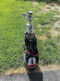 black, white, and red golf club set 379 mi