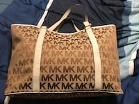 monogrammed brown and white Michael Kors tote bag