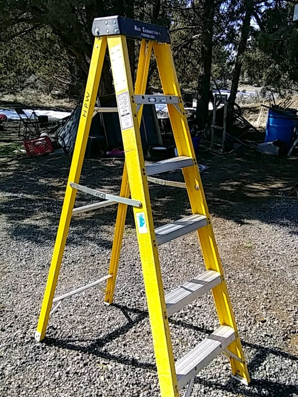 yellow and gray Werner a-frame ladder