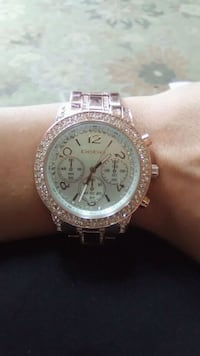 round silver Michael Kors chronograph watch with l