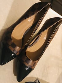 Pair of brown leather slip on shoes Kitchener, N2R 0E6