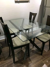 rectangular glass top table with four chairs dinin