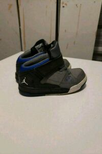 pair of black-and-blue Nike basketball shoes Edmonton, T6N 1C4