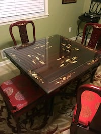 Oriental Dining Table with glass top and 4 chairs  Cartersville