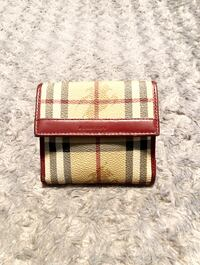 Vintage Burberry wallet paid $480 Authentic; normal wear. The edges of the wallet have signs of wear, and the lining is loose other then that good condition! 8 credit card slots; 1 bill compartment and coin compartment.