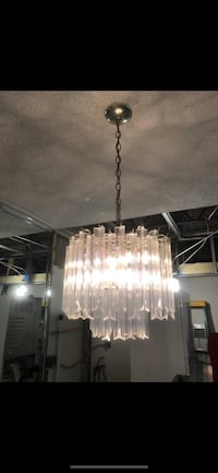 Beautiful acrylic crystal chandelier. Looks like new with brass accent plate. Pompano Beach, 33060