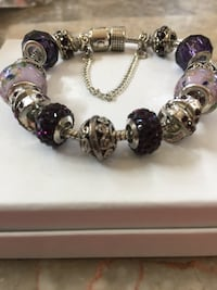 Bracelet loaded with purple and silver charms. Also has a Safety Chain   Aldie, 20105