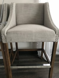 3 bar height upholstered chairs with light grey fabric
