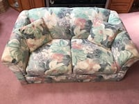 White, green, and pink floral fabric loveseat 741 mi
