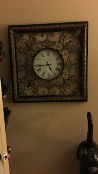 round white and black analog wall clock with square brown and black steel frame 2231 mi