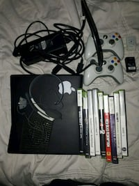 black Xbox 360 console with controller and game ca Abbotsford, R6W 2M1