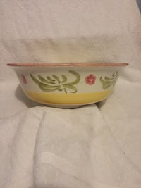 white and yellow floral ceramic bowl