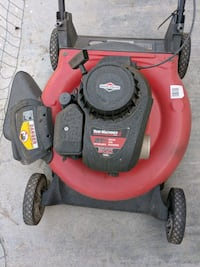red and black push mower 2261 mi
