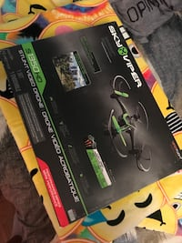 black and green Sky Viper S1350 HD drone box
