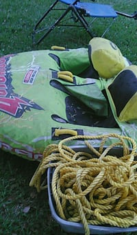 green and yellow inflatable boat