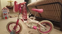 toddler's pink and white bicycle Germantown