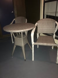 two gray wicker padded chairs Tampa, 33618