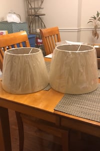 Two tan-colored hanging lamp shades