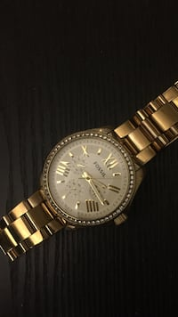 Round gold-colored fossil chronograph watch with l Toronto, M6J 2W8