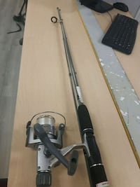 Spin cast fishing rod
