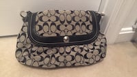 Coach small handbag from signature collection w/ some stain at Bottom Woodbridge, 22191