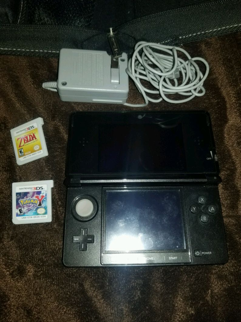 black Nintendo 3DS with game cartridges for sale  Lynn