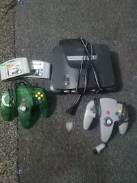 black Nintendo 64 console with controllers and game cartridges Hampton, 23666