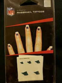 Panthers finger nail tattoo