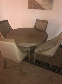 Round brown wooden table with four chairs dining set Capitol Heights, 20743