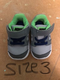 pair of gray-and-green Nike sneakers Rome, 30165