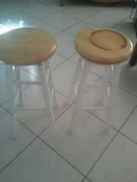 two brown-and-white wooden stools