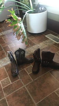 two pairs of black leather cowboy and harness boots